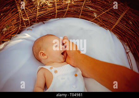 Family love. Baby sleep in bed. Mother touch newborn baby with love. Mother and child. I will love you forever. Peaceful sleep - Stock Photo