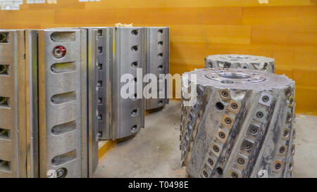 Big rollers from the machine on standby with the sharp edges on them - Stock Photo