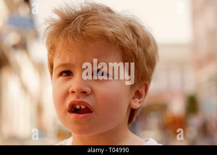 Trendiest haircut. Little child eating outdoor. Small boy with stylish haircut. Little child with short blond hair. Healthy hair care habits. Its - Stock Photo