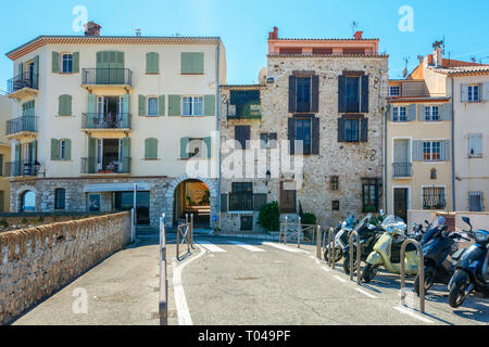 Antibes, France, September 11, 2018: Premises built in old and new architecture along the promenade Amiral de Grasse in Antibes - Stock Photo