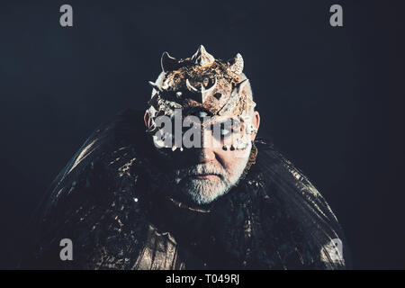 Horror and fantasy concept. Alien, demon, sorcerer makeup. Man with third eye, thorns or warts. Demon on black background, copy space. Senior man with - Stock Photo