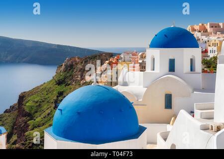 Blue and white domed churches on Santorini Greek Island, Oia town, Santorini, Greece. - Stock Photo
