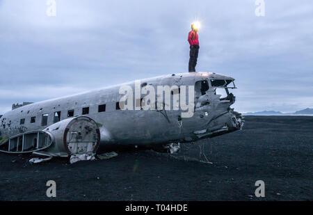 Wreckage of crashed airplane Dakota United States Navy Douglas Super DC-3 on the coast of iceland black sand beach. Solheimasandur, Iceland - Stock Photo