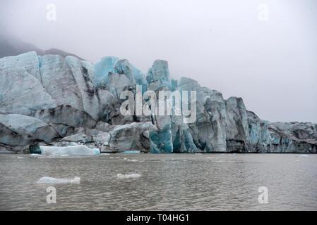 Icebergs in Jokulsarlon beautiful glacial lagoon in Iceland. Jokulsarlon is a famous travel destination in Vatnajokull National Park,  Iceland, - Stock Photo
