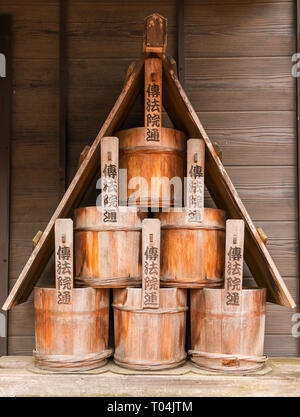 A stack of traditional Japanese ritual wooden buckets