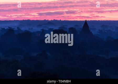 Temples and historical pagodas of the Archaeological Zone in Bagan in the early morning sunlight. Myanmar (Burma). - Stock Photo