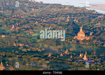 Aerial view of temples and historical pagodas of the Archaeological Zone in Bagan in the early morning sunlight. Myanmar (Burma). - Stock Photo