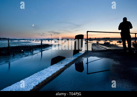 End of the day on a jetty as the sun sets in Bosham, West Sussex - Stock Photo