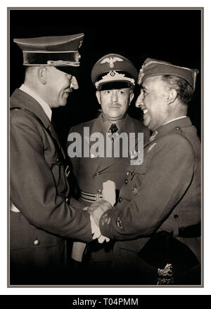 Adolf Hitler and Eberhard von Stohrer greeting General Franco at Hendaye, moments after arriving from his train at around 15:15. 23rd October 1940 Francisco Franco (1892 - 1975) Spanish general and dictator who governed Spain from 1939 to 1975 greeting Adolf Hitler, Nazi German dictator (1889 - 1945). meeting at Hendaye near the Spanish border. - Stock Photo