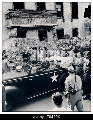 President Truman 1945 Berlin Ruins Post WW2 1945 photograph ( L to R ) in rear seat of car: President Harry S. Truman, Secretary of State James Byrnes, and Fleet Admiral William Leahy inspect the ruins of Hitler's Chancellery in Berlin, Germany. President Truman is in Germany to attend the Potsdam Conference. - Stock Photo