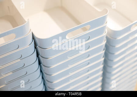 Colourful Plastic container box Stack Storage Logistic business.plastic containers stack in a store.selective focus.Concept of eco pollution.shopping - Stock Photo