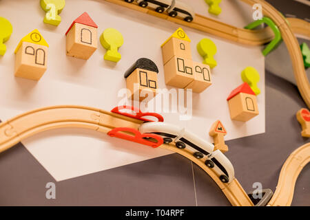 Toy Train in brick town.wooden trains in indoor playground or amusement center.Kindergarten or preschool play room.Toys for kids Play set Educational - Stock Photo