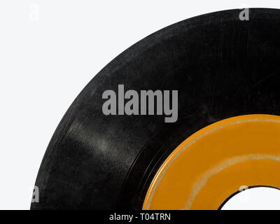 Vintage Vinyl 45rpm record close up with copy space. - Stock Photo