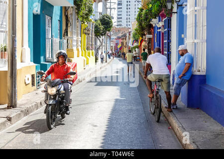 Cartagena Colombia Old Walled City Center centre San Diego Hispanic resident residents man motorcycle rider colorful facades colonial homes narrow str - Stock Photo