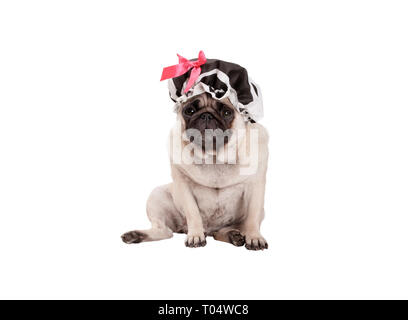 unhappy pug puppy dog with shower cap, sitting down, ready for taking a bath, isolated on white background - Stock Photo