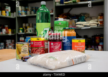 A selection of donated food and drink in a UK Trussell Trust local church food bank ready for food parcels - Stock Photo