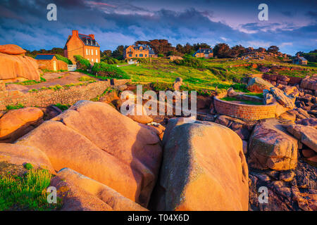 Spectacular holiday villas with colorful granite rocks at sunset, Perros Guirec, Brittany (Bretagne) region, France, Europe - Stock Photo