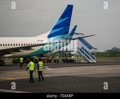 Yogyakarta, Indonesia - Apr 15, 2016. A Boeing 737-800 airplane of Garuda docking at Adisucipto International Airport (JOG). - Stock Photo