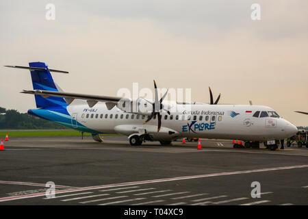 Yogyakarta, Indonesia - Apr 15, 2016. An ATR 72-600 airplane of Garuda docking at Adisucipto International Airport (JOG). - Stock Photo