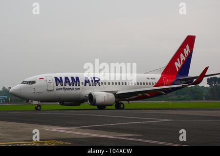 Yogyakarta, Indonesia - Apr 15, 2016. A Boeing 737-500 airplane of NAM Air docking at Adisucipto International Airport (JOG). - Stock Photo