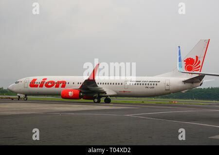 Yogyakarta, Indonesia - Apr 15, 2016. A Boeing 737-900ER airplane of Lion Air docking at Adisucipto International Airport (JOG). - Stock Photo