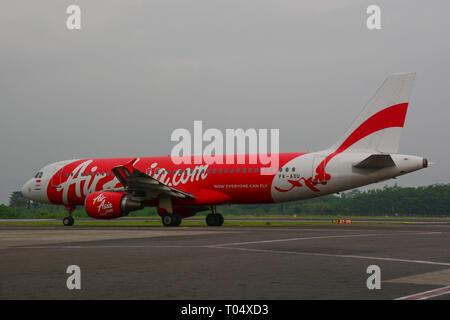 Yogyakarta, Indonesia - Apr 15, 2016. An Airbus A320 airplane of AirAsia docking at Adisucipto International Airport (JOG). - Stock Photo