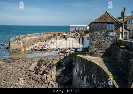 Looking towards Coverack harbour at low tide with boats aground on their moorings Coverack Cornwall UK - Stock Photo