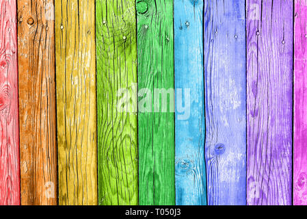 Old planks in the colors of the rainbow. Colorful wood background - Stock Photo
