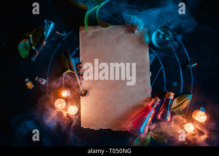 Magical scroll template for ad or certificate. Blank parchment with candles and potions. Dark still life with copy space - Stock Photo