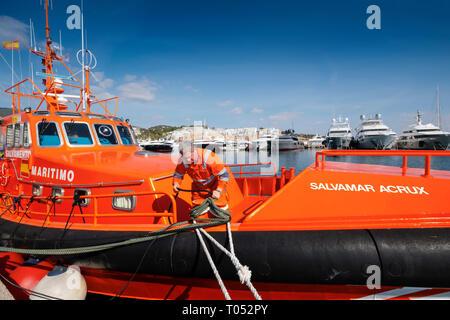Salvamento Maritimo. Marine rescue boat. Lifeboat moored in the harbor at Marina Puerto Portals, Palma de Mallorca. Majorca, Balearic Islands, Spain E - Stock Photo