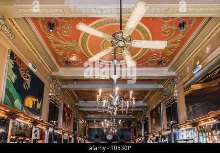 Lisbon, Portugal - 12 28 2018: Peope and Art Nouveau interior design of the Café A Brasileira - Stock Photo