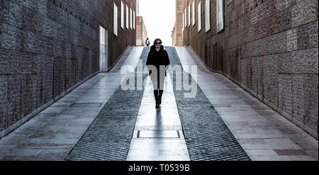 Belem, Lisbon / Portugal - 12 28 2018: Young white woman with small backpack walking through the museum of contemporary art - Stock Photo