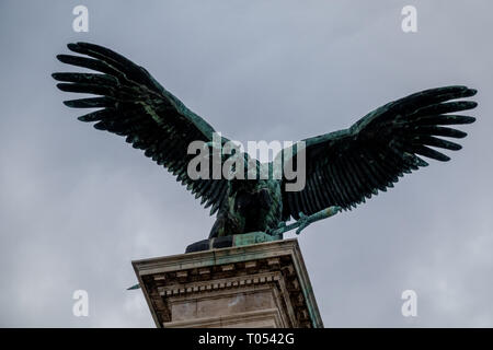 Sculpture of vulture with spread wings with the royal sword in its claws in Budapest, Hungary - Stock Photo