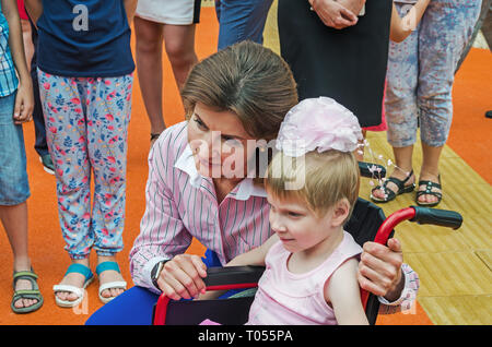 Dnipro, Ukraine - June 27, 2018: First Lady Marina Poroshenko and children with special educational needs at opening of an children inclusive park - Stock Photo