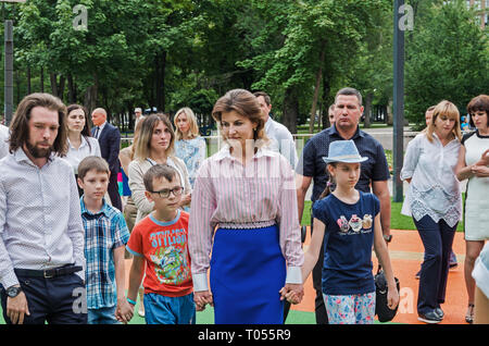 Dnipro, Ukraine - June 27, 2018: First Lady Marina Poroshenko and architect Sergey Derbin at opening of an inclusive park - Stock Photo