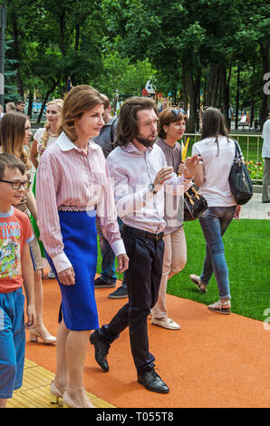 Dnipro, Ukraine - June 27, 2018: First Lady Marina Poroshenko with kids and architect Sergey Derbin at opening of an inclusive park - Stock Photo
