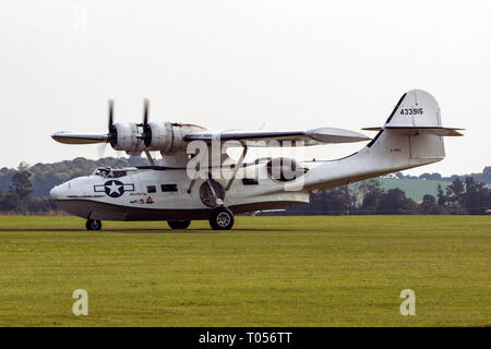 A Consolidated PBY-5A landing at Duxford airfield - Stock Photo