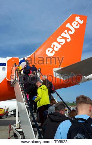Passengers ascend the steps to board an Easyjet flight at Bristol Airport, Lulsgate, Bristol, UK. - Stock Photo