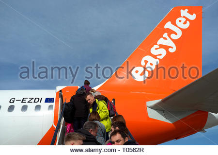Passengers ascend the steps to board an Easyjet flight at Bristol Airport, Lulsgate, Bristol, UK. - Stock Photo