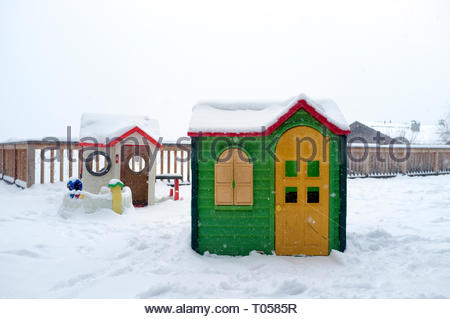 Two plastic Wendy houses, in the snow, in France. - Stock Photo