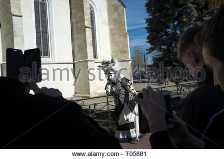 Mobile phone users photograph a participant at the Annecy Venetian Carnival. Annecy. Auvergne-Rhone-Alpes, south east France. - Stock Photo