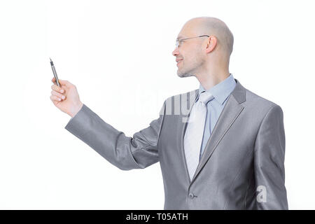 in full growth.handsome businessman pointing at a copy space. - Stock Photo