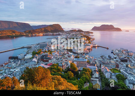Alesund is a port and tourist city in Norway. Famous tourist attraction. View point on Mount Aksla. Beautiful sunset - Stock Photo