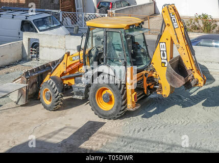 Limassol, Cyprus - November 4, 2018: Large yellow JCB tractor on a building site. Vehicle is large in the frame. - Stock Photo
