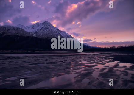 Pioneer Peak stands peacefully overlooking the mud flats around the Knik river. - Stock Photo