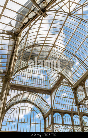 Madrid, Spain - November 2, 2018: Interior view of Crystal Palace, Palacio de Cristal, in Retiro Park. View against blue sky. - Stock Photo