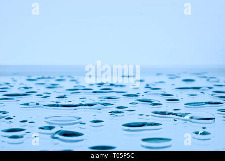 Large drops of water on horizontal glass - Stock Photo