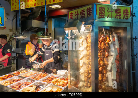 Taipei, Taiwan - March 2019: Street food vendor at Shilin night market. - Stock Photo