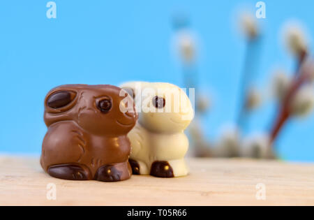 chocolate easter bunny couple background with copy space, brown and white - Stock Photo