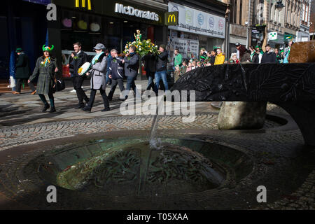 Cheshire, UK. 17th March 2019.  The annual St Patrick's Day Parade took place, starting at 10.30 in the morning from The Irish Club in Orford Lane to 'The River of Life' in Bridge Street in the Town Centre, where a short service was held to remember the 25th anniversary of the Warrington Bombing Credit: John Hopkins/Alamy Live News - Stock Photo